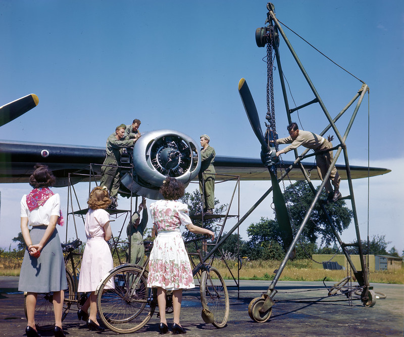 English women watching Air Force maintenance crew