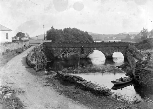 The old rustic bridge below the town