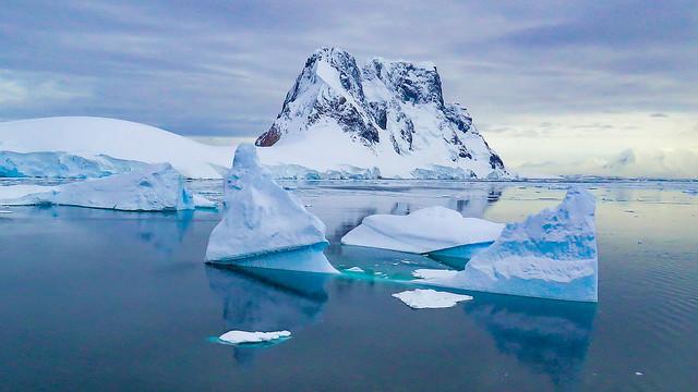 Antartica blue iceberg refllections