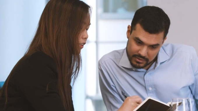 Two business students discussing a project