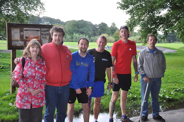 Three supporters, two runners and a guide