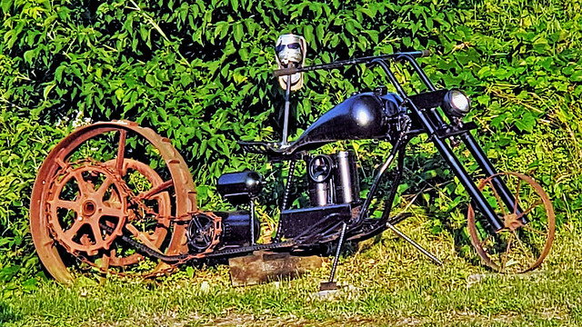 Robot head on a steampunk motorbike?