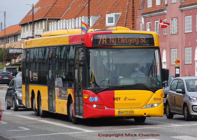 Copenhagen Pride flag flying day on the buses sees a crosswind on Scania Omnilink 1204