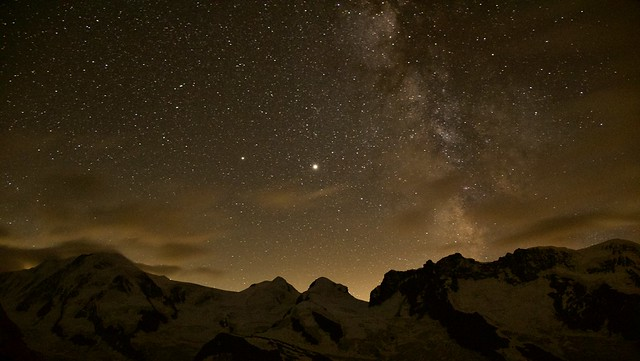 Among the milky way, stars and mountains