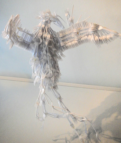 A bird made of white plastic forks in the Emily Carr School of Art in Vancouver, Canada