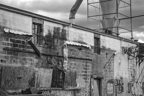exterior facade architecture urbanlandscape urbandecay riverdistrict railroaddistrict ashevillewastepapercompany asheville northcarolina nikond3300 nikonnikkor55mmf35 primelens blackandwhite monochrome monochromatic digital