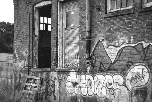 exterior architecture mill abandoned brick graffiti railroaddistrict urbandecay asheville northcarolina nikond3300 nikonnikkor55mmf35 blackandwhite urbanlandscape monochrome monochromatic digital