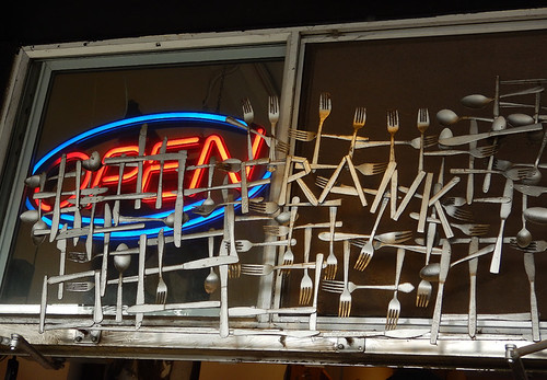 A decorative window grille made up of welded forks, knives and spoons at a shop in Vancouver, Canada