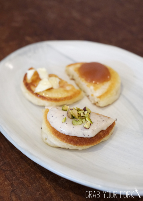 Pikelets with wattle seed cream, pistachios, honey, butter and salted caramel sauce at Bush Redfern Sydney