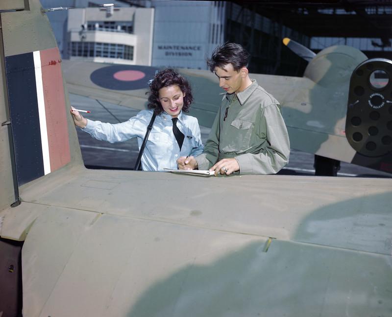 Lt. Robert Williams briefs pilot Lorena Daily