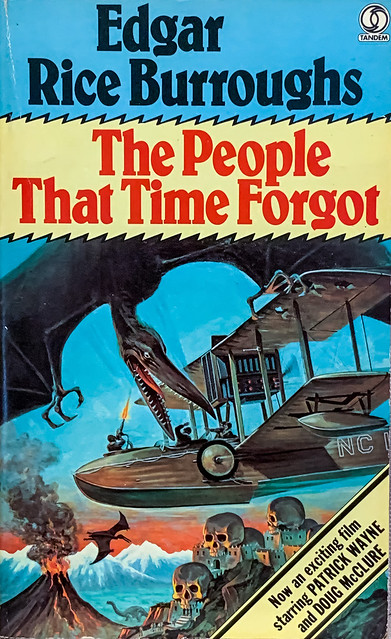 """""""The People That Time Forgot"""" by Edgar Rice Burroughs. London: Tandem Books 14832, (1977).  British paperback edition. Movie tie-in. Cover Art by George Akimoto."""