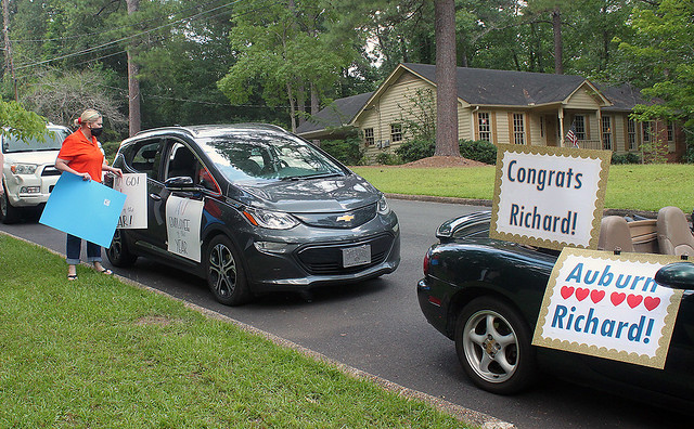 Cars with congratulations signs on them