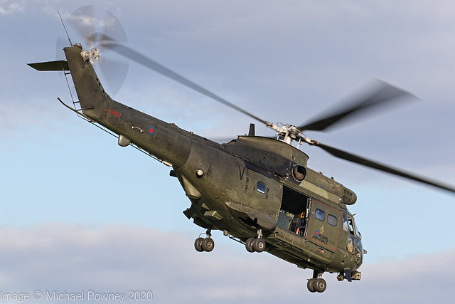 ZA940 - 1981 build Westland Puma HC.2, setting course on departure from Barton