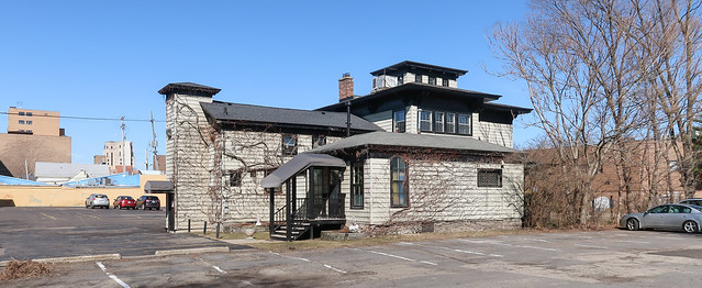 A house from 1863 is now a commercial property surrounded by a huge parking lot.