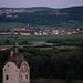 Full moon rising over Lower Austria and Stein on the Danube on a summers evening just after a pink sunset, Austria