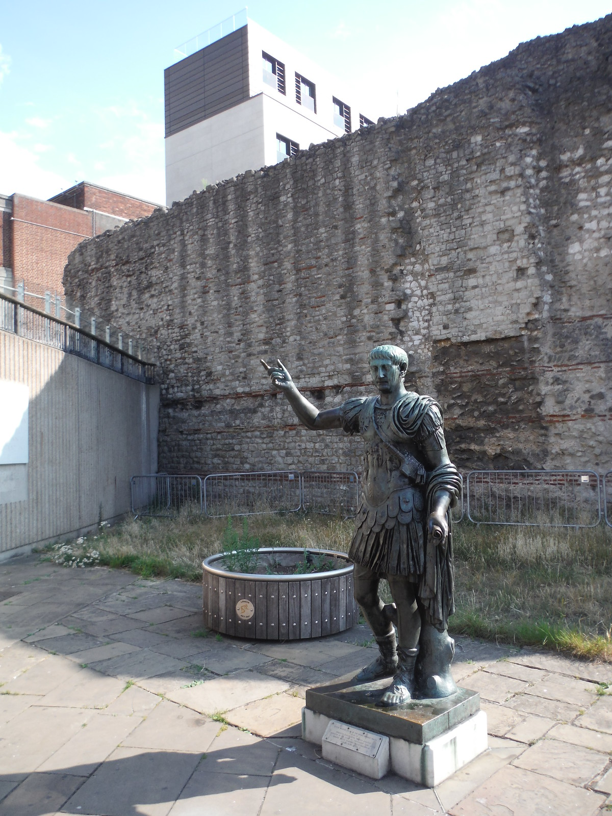 Emperor Trajan and one of the largest surviving visible pieces of the Wall SWC Short Walk 47 - The London Wall