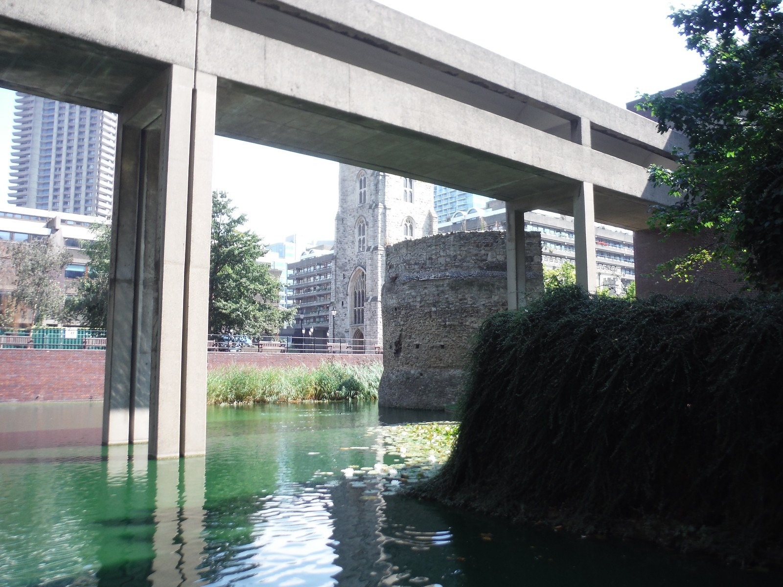 Bastion 12 of the London Wall across the Barbican's ornamental Lake SWC Short Walk 47 - The London Wall