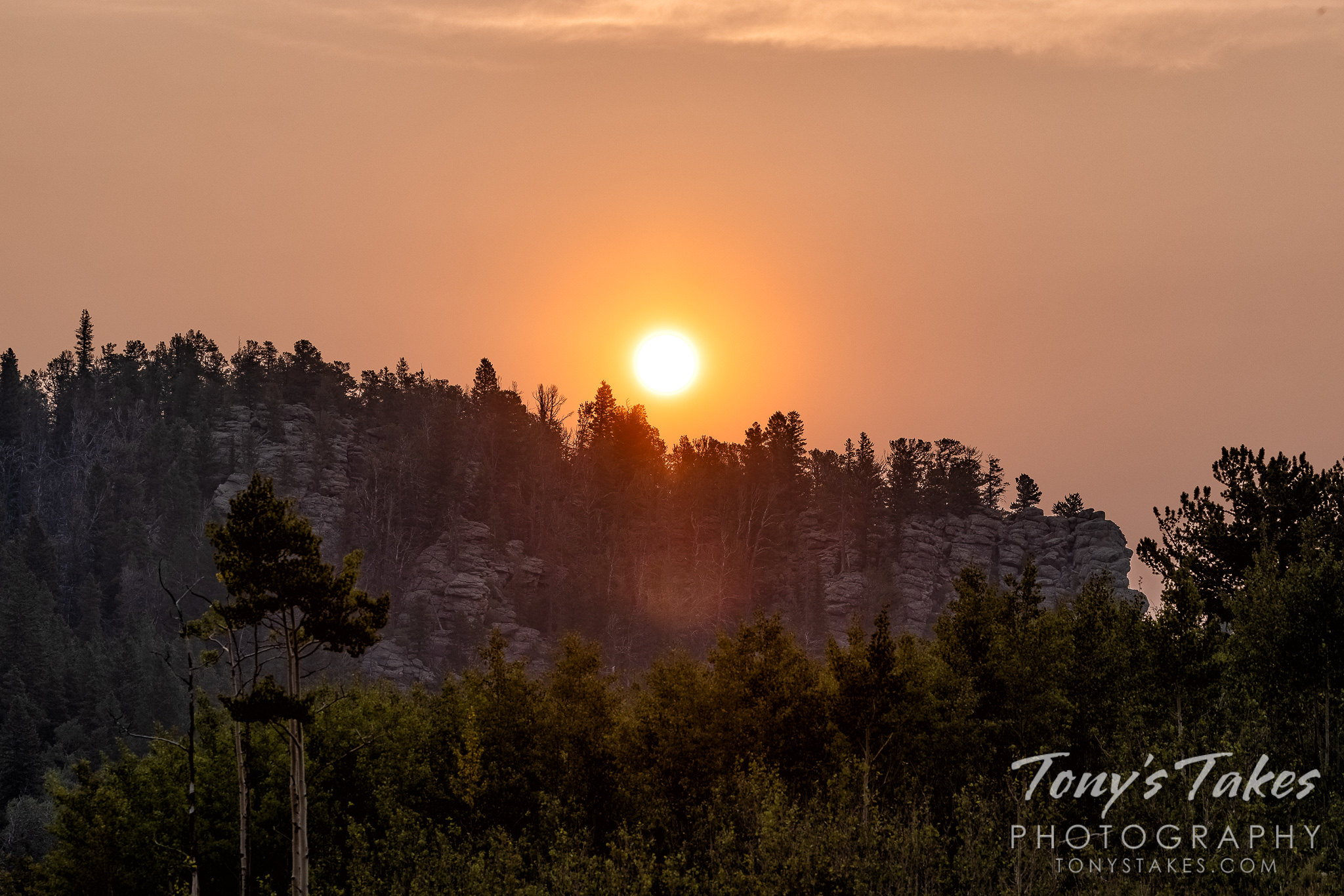 Smoky sunrise over a rocky landscape