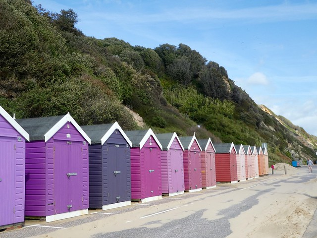 Colourful beach huts along Bournemouth beach