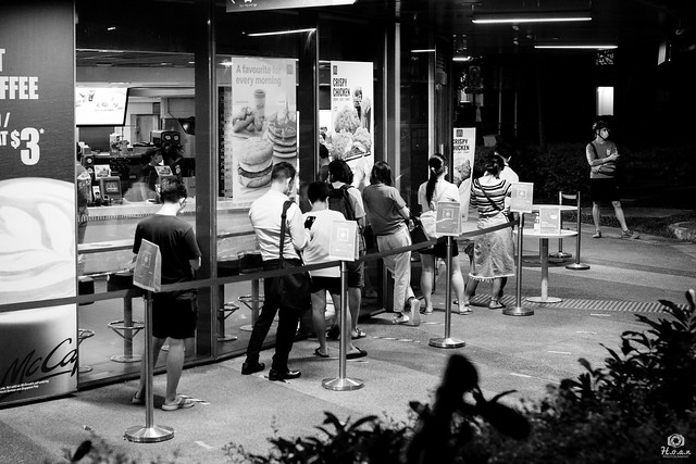 Waiting with phones - Singapore