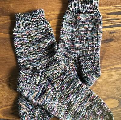 Brandi (@thegreenbuttonjar) is not a fan of wearing socks but these that she knit! Pattern My Favorite Vanilla Socks by Meaghan Schmaltz (@notsorryknitter). Yarn from The Green Button Jar.