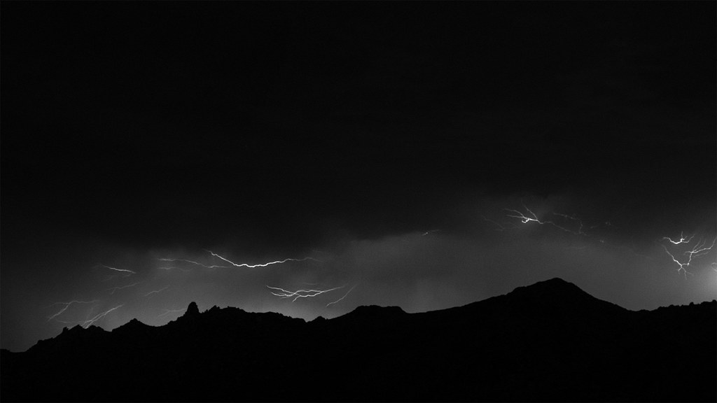 Flashes of lightning streak above Tom's Thumb and the McDowell Mountains on a stormy summer night in Scottsdale, Arizona on August 17, 2020. Originals: _CAM4433.arw, _CAM4434.arw