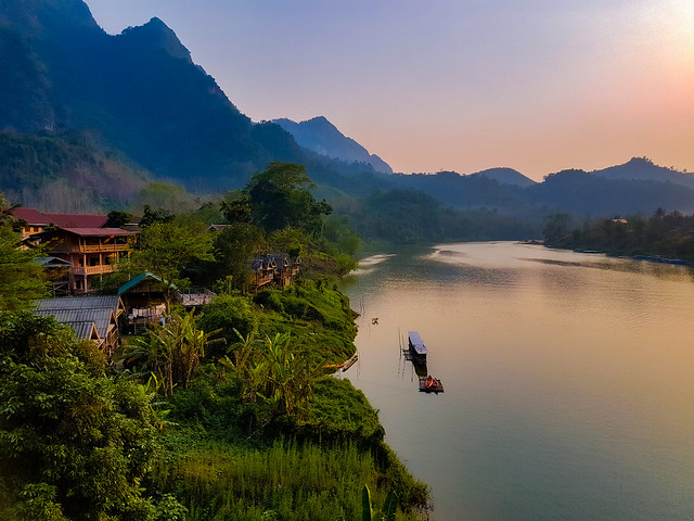 Boat on the Nam Ou River at sunset in Nong Khiaw, Laos (Explore)