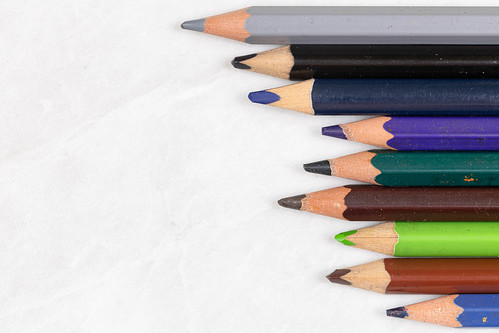Top view of Wooden Color Pencils with copy space above white background | by wuestenigel
