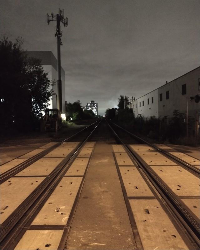 9:05 pm, looking west #toronto #bartlettavenue #railwaycrossing #rail #night #dovercourtvillage #davenport #skyline