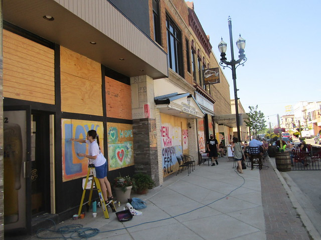 Painting plywood along 6th Avenue