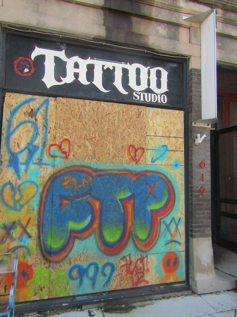 "Tattoo studio - ""Fuck the Police"" graffiti mural"