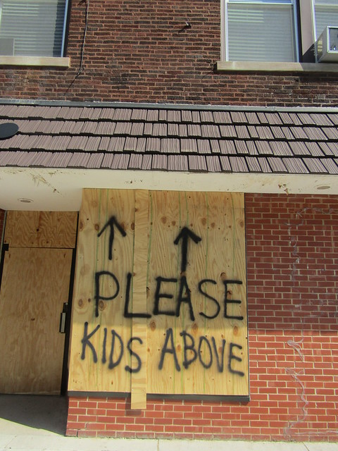 "Inner Child comic book store window - ""Please, Kids Above"""