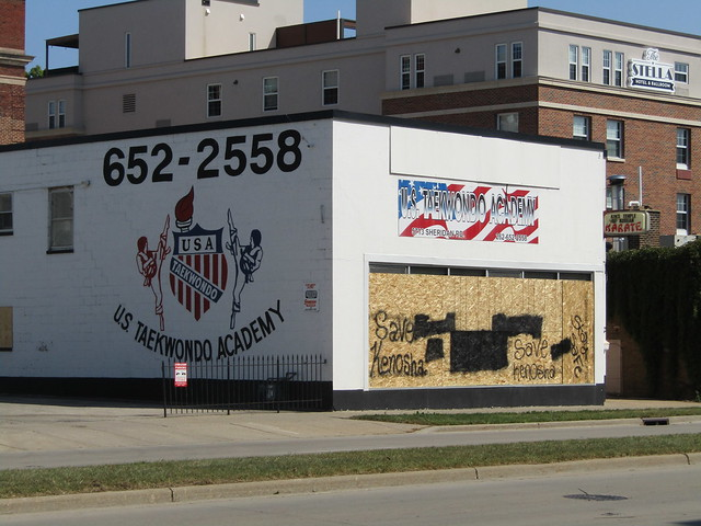 "US Taekwondo Academy - ""Save Kenosha"" graffiti on plywood"