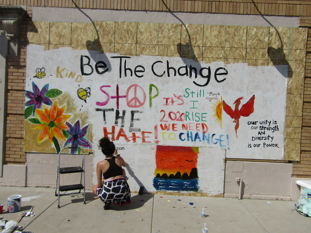 "Students painting plywood at the Crystal Building - ""Be the Change"""