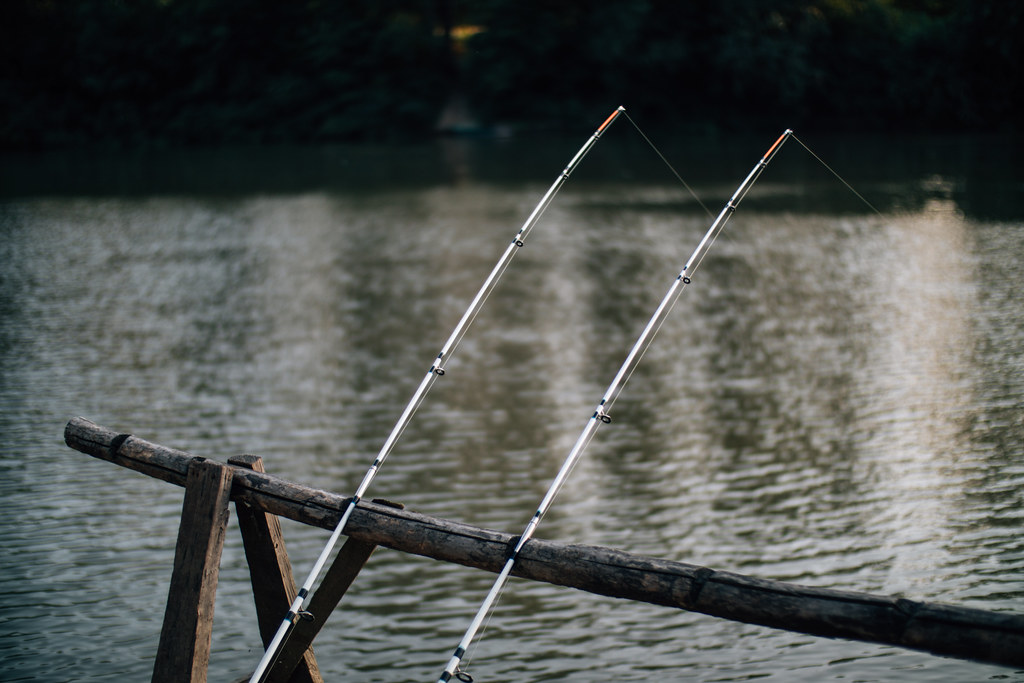 Fishing rods leaning on a wooden rail | Ivan Radic | Flickr