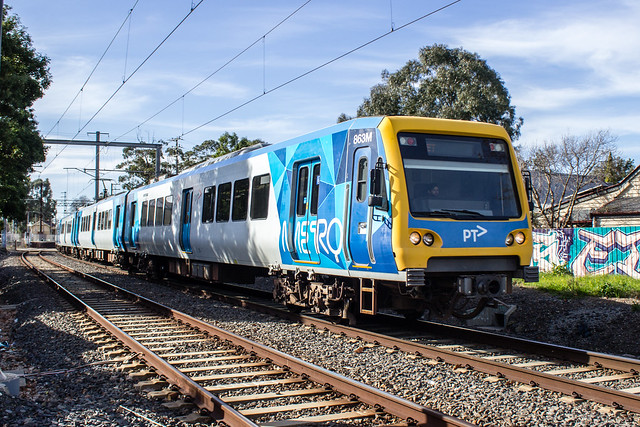 Xtrapolis train running an Up service to Flinders Street at Cunningham Street level crossing, Northcote