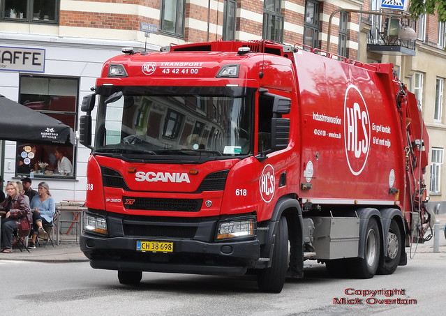 Next Generation Scania P320 XT CH38898 trash truck sits outside hipster cafe in Copenhagen
