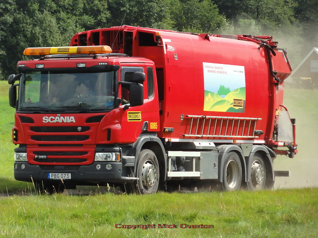 Swedish Scania P320 trash truck PBG073 kicks up dust on a farm