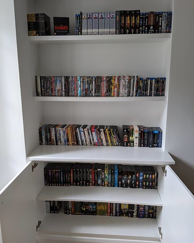 Nothing says home like a wall of DVDs (except, perhaps, books - which is what I'm doing next) | by Dave Cross