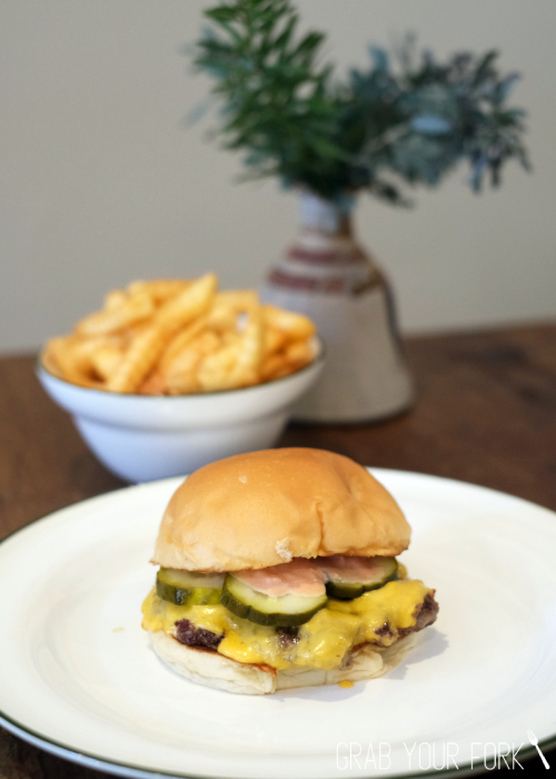 The famous cheeseburger with crinkle cut chips from Bush Redfern Sydney