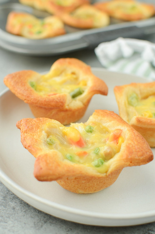 Chicken Pot Pie Cups - only 4 ingredients and ready in 30 minutes! Crescent roll cups filled with chicken pot pie filling and baked until golden brown and delicious.