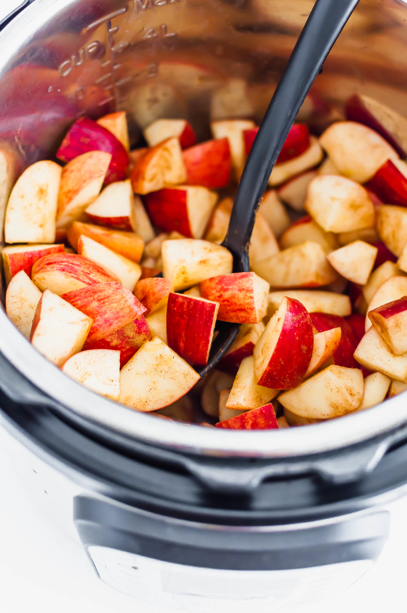 Apples and cinnamon in the Instant Pot ready to cook.