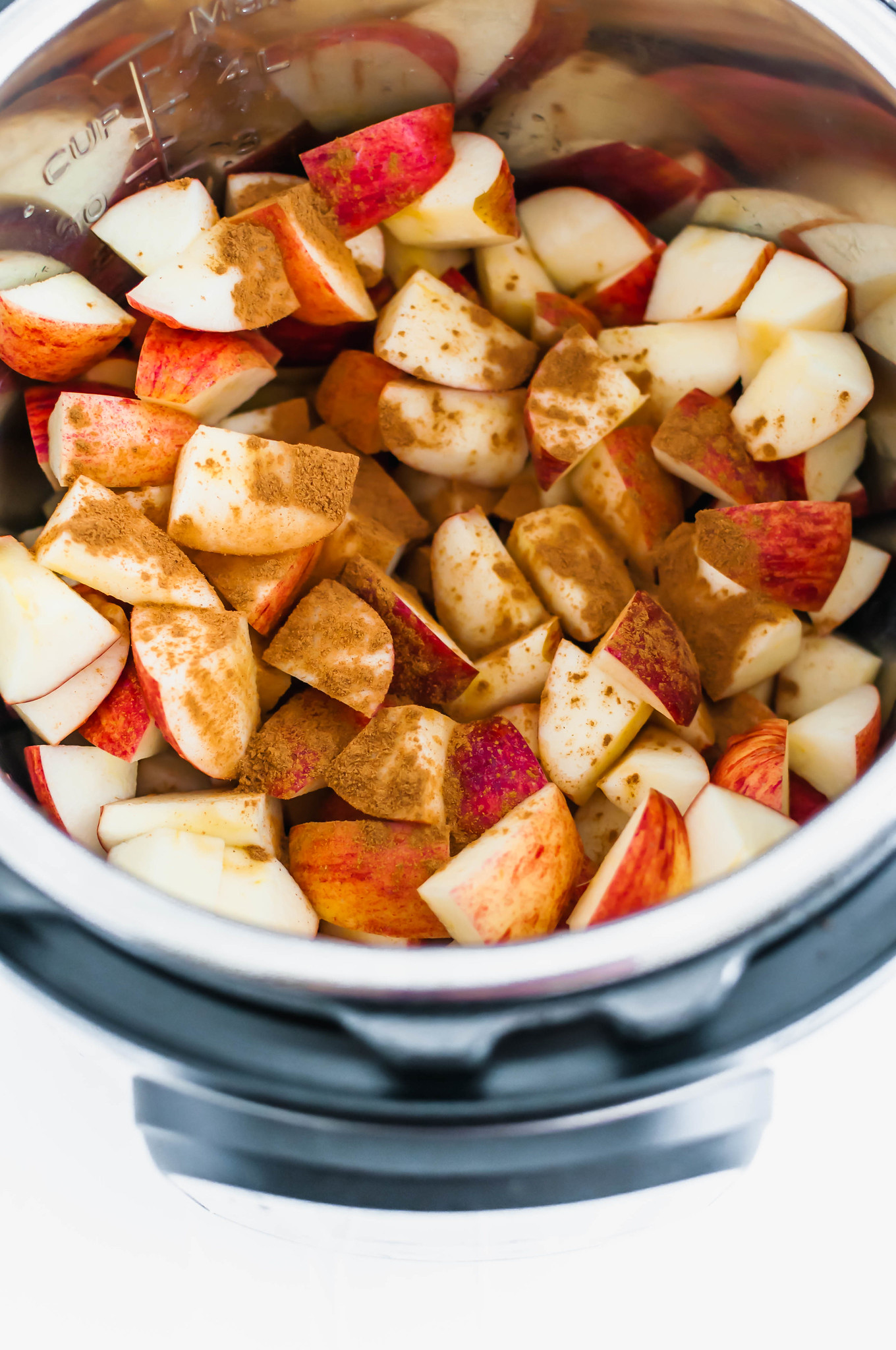 Ingredients, apples and cinnamon, in Instant Pot.