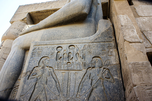 Engravings at Ramses II colossal statue in Egypt's Luxor temple