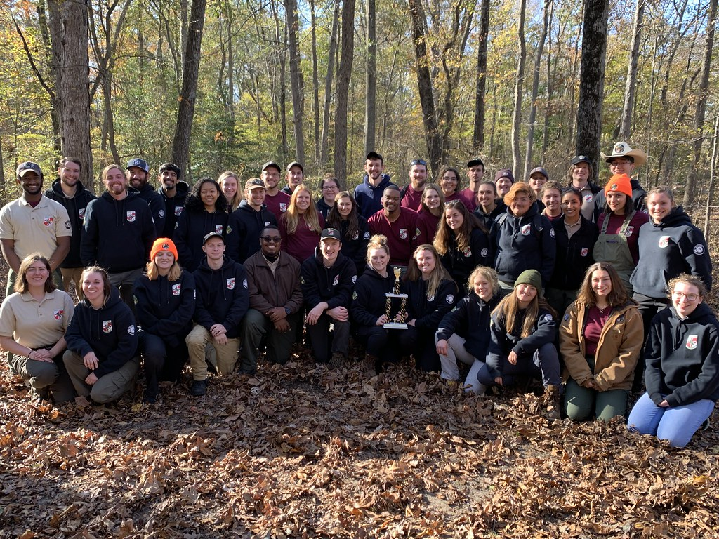 Photo of group in a wooded area