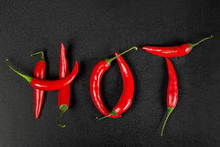 Top view hot made from red chili peppers on black | by wuestenigel