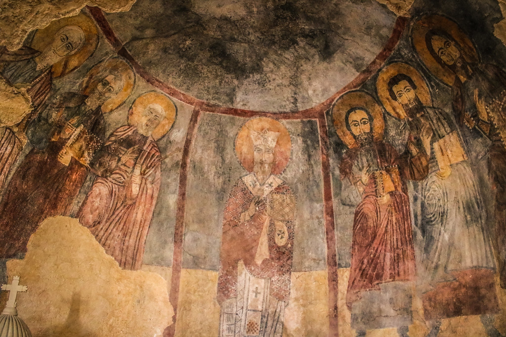 Saint Charbel Maad Church frescoes depicting a bishop with Saints Peter and Paul and the Four Evangelists