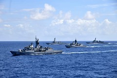 In this file photo, ships from the Royal Australian Navy, Japan Maritime Self-Defense Force and U.S. Navy steam together during post-RIMPAC operations, Sept. 2. (JMSDF photo)