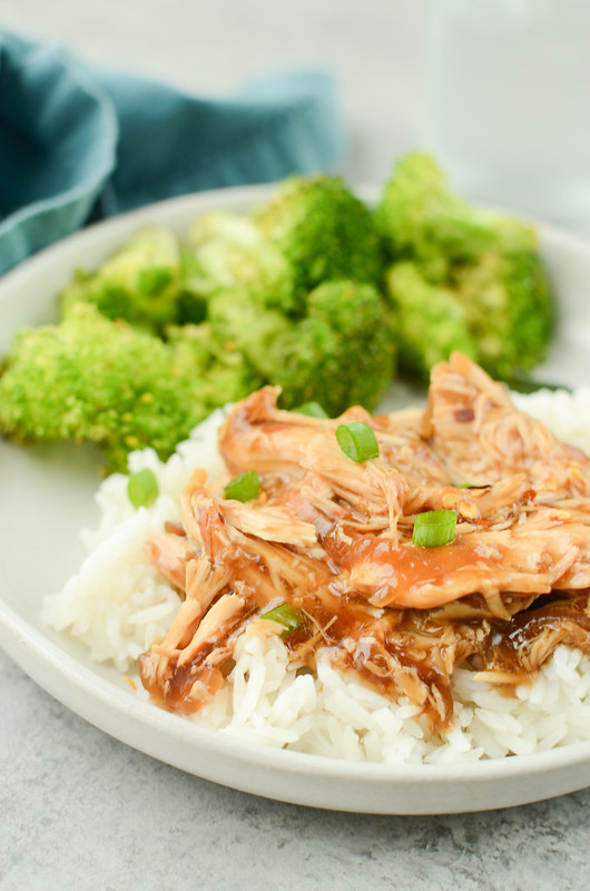 Slow Cooker Teriyaki Chicken is your new favorite takeout fakeout! Chicken breasts cooked in a sweet and slightly spicy sauce and served over rice!