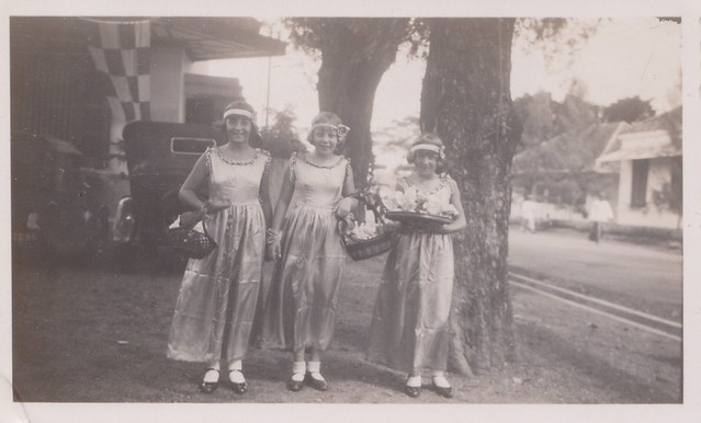 Location unknown - Three girls in party clothes in front of a vintage car